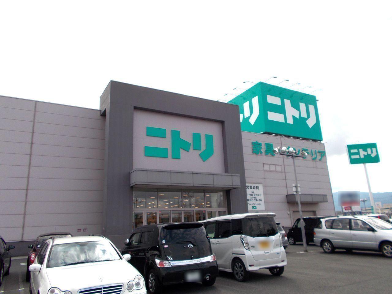 ショッピングセンター徒歩14分(約1100m)