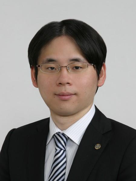 丸岡 稔弘 氏